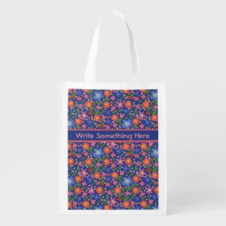 青い買い物袋のかわいらしい民芸のスタイルの花柄 エコバッグ