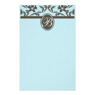 青およびブラウンのペイズリーの花柄のモノグラム 便箋