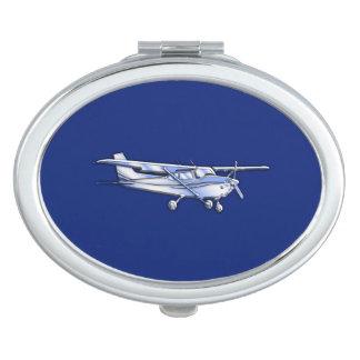 青の航空機のクロムセスナのシルエットの飛行