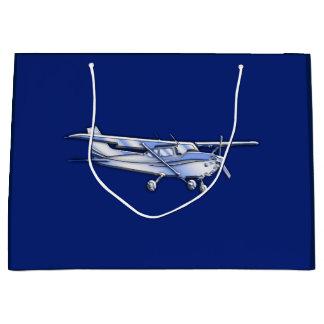 青の航空機のクロムセスナのシルエットの飛行 ラージペーパーバッグ