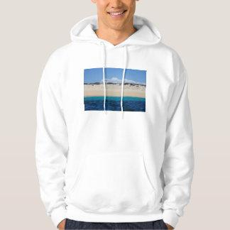 青空の下の砂浜の海洋波 パーカ