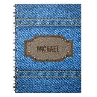 革一流のラベルが付いている青いデニムのジーンズ ノートブック