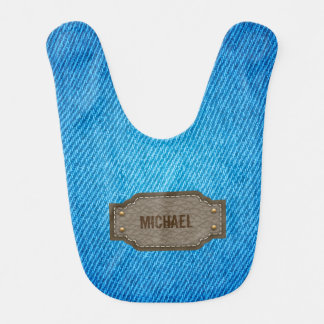 革一流のラベルのベビー用ビブが付いている青いデニムのジーンズ ベビービブ