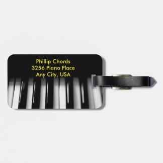 革紐が付いているピアノ鍵の荷物のラベル ラゲッジタグ