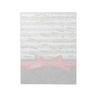 音楽ノートおよび模造ので赤いリボン ノートパッド