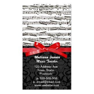 音楽ノートおよび模造ので赤いリボン ビジネスカード
