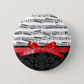 音楽ノートおよび模造ので赤いリボン 缶バッジ