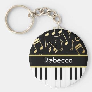 音符およびピアノ鍵の黒および金ゴールド キーホルダー