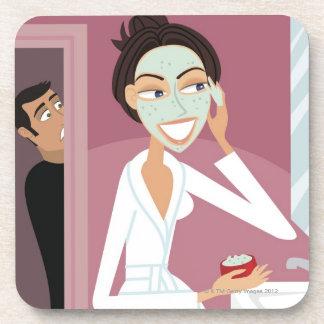 顔のマスクを加えている女性 コースター
