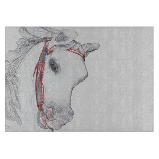 風変わりな回転木馬の馬の顔の鉛筆のスケッチ カッティングボード
