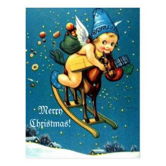 飛行の揺り木馬のメリークリスマスのかわいい天使 ポストカード
