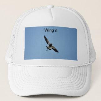 飛行中のチドリの鳥 キャップ