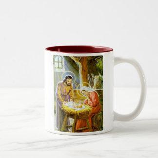 飼い葉桶のクリスマスの出生のイエス・キリスト ツートーンマグカップ