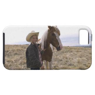 馬が付いている範囲の確実で若い女性のカーボーイ iPhone SE/5/5s ケース