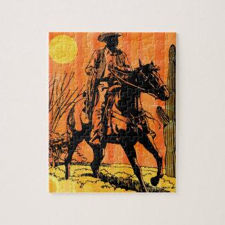 馬に乗ってカウボーイの乗馬砂漠で ジグソーパズル