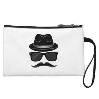 髭、帽子およびサングラスを持つクールなヒップスター クラッチ