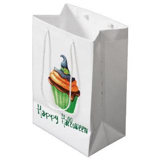 魔法使いの帽子が付いているハッピーハローウィンのカップケーキ ミディアムペーパーバッグ