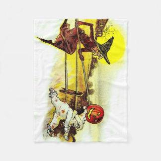 魔法使いの衣裳の子供のジャックOのランタンのカボチャ フリースブランケット