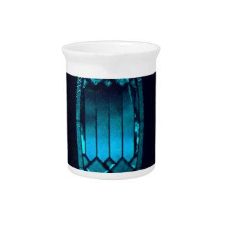 鮮やかな楕円形のティール(緑がかった色)の切子ガラスのさわやかな精神の引用文 ピッチャー