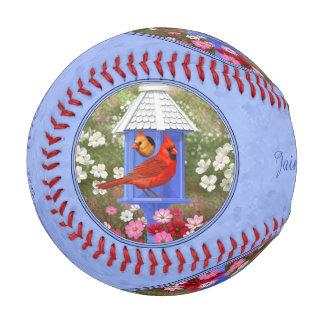 (鳥)ショウジョウコウカンチョウおよび円形の巣箱の青 野球ボール