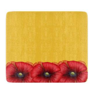 黄色いガラスまな板の赤いケシの集り カッティングボード