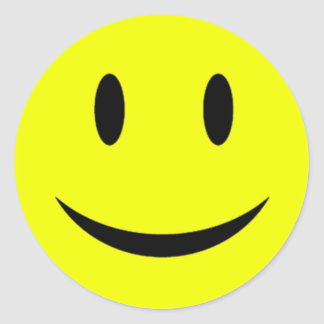黄色いスマイリーフェイスのステッカー ラウンドシール