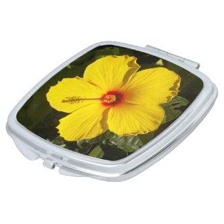 黄色いハイビスカスの花の正方形のコンパクトの鏡