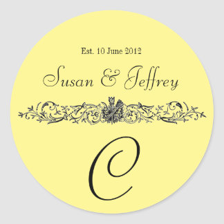 黄色いモノグラムのロゴは日付の結婚式のラベルを示します ラウンドシール