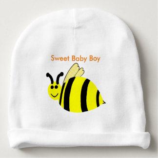 黄色い微笑ののまわりにの菓子の男の赤ちゃん ベビービーニー