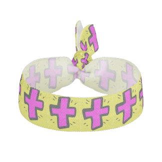 黄色い背景が付いているピンクの十字 ヘアタイ