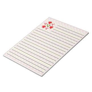 黄色および赤い種族パターン ノートパッド