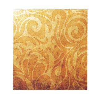 黄色く華美な渦巻パターン ノートパッド