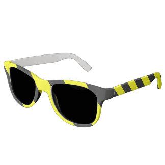 黄色く黒い関心の警告は縞で飾ります サングラス