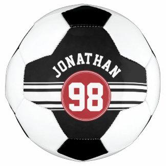 黒いおよび赤ジャージーの名前をカスタムする数を遊ばします サッカーボール