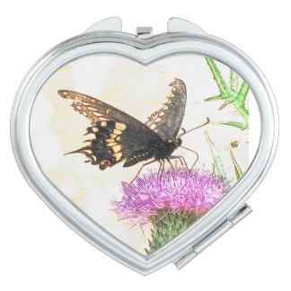 黒いアゲハチョウの蝶スケッチのハートの鏡