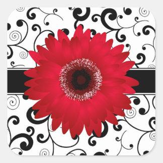黒いスクロールデザインのシールを持つ赤いガーベラのデイジー スクエアシール