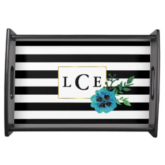 黒いストライプ及び青い花のモノグラムの皿 トレー