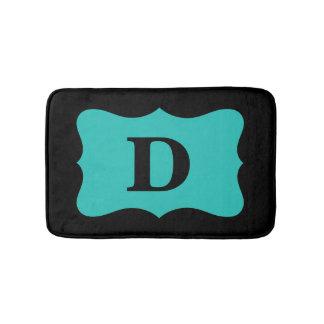 黒いターコイズのティール(緑がかった色)の青いモノグラムのイニシャルの家 バスマット
