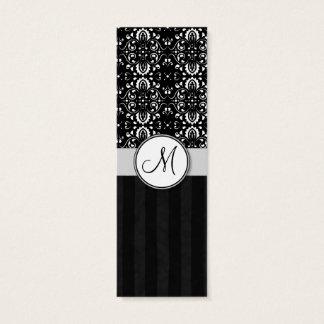 黒いダマスク織の白はモノグラムと縞で飾り、 スキニー名刺