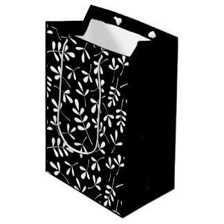 黒いパターンの分類された白の葉 ミディアムペーパーバッグ
