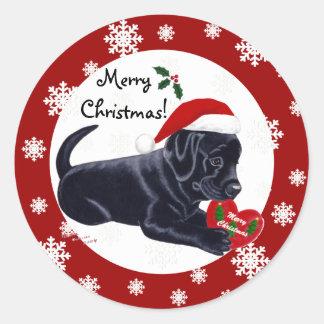 黒いラブラドル・レトリーバー犬のクリスマスの雪片 ラウンドシール