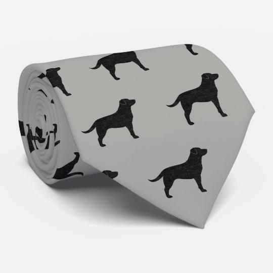 黒いラブラドル・レトリーバー犬はパターンのシルエットを描きます ネクタイ