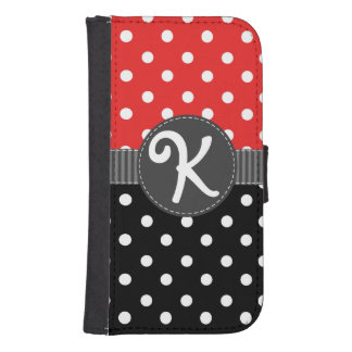 黒いリボンが付いている赤く、黒く及び白い水玉模様 ウォレットケース