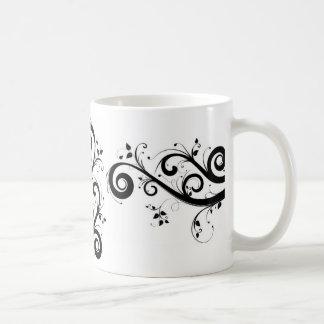 黒い渦巻パターンが付いている白いマグ コーヒーマグカップ