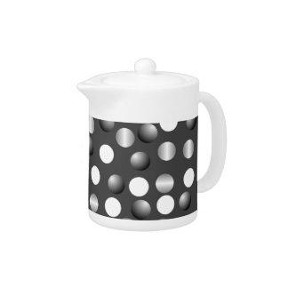 黒い灰色の水玉模様の小さいティーポット