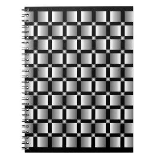 黒い背景が付いている灰色の正方形のパターン ノートブック