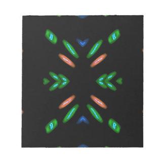 黒い背景のかわいらしいモモの緑 ノートパッド