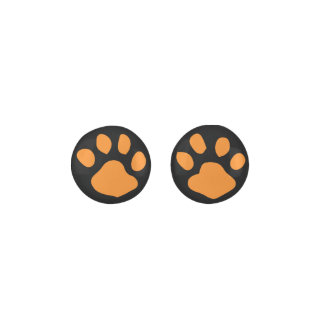 黒い背景のオレンジ動物の足のプリント ピアス