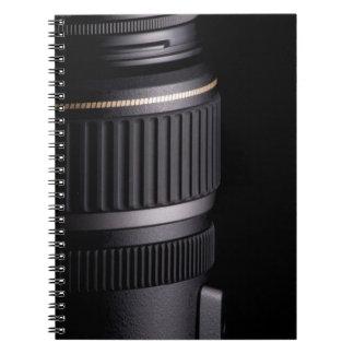黒い背景のモダンなカメラレンズの閉めて下さい ノートブック