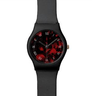 黒い背景の赤い点 腕時計